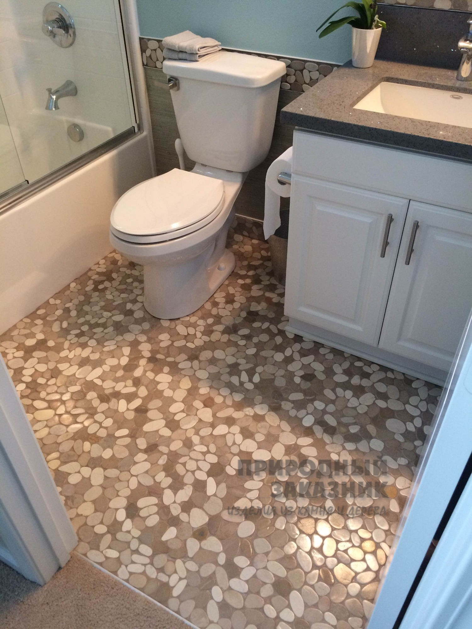 Pebble tile floor bathroom